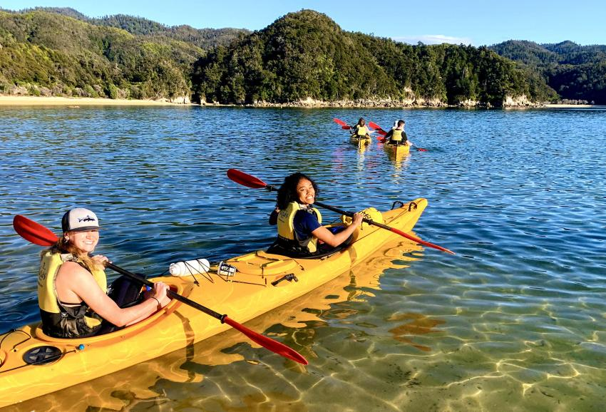 Aquilla Lee with friends in a kayak in New Zealand