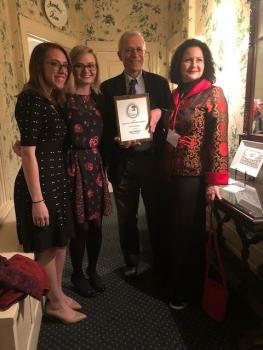 Dr. Wolff with three members of his family and the award