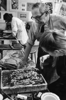Benton Spruance consulting on a student's lithography stone in the printmaking studio of Brookside Hall, circa 1965.