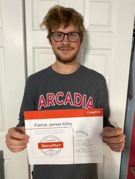 Arcadia University student Patrick Kirby with certificate