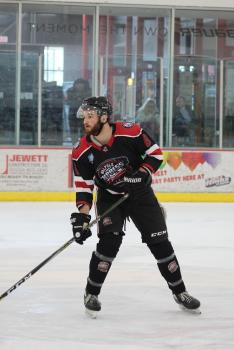 Arcadia University student Sam Whitehouse playing hockey